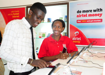An Airtel Uganda customer care advisor attends to a customer