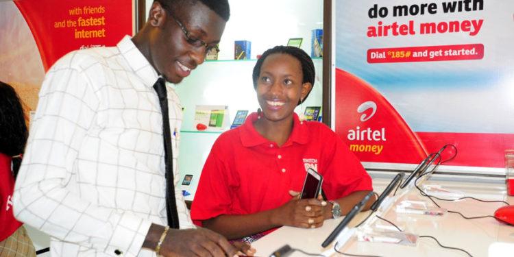 An Airtel Uganda customer care advisor attends to a customer
