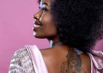 Bobi Wine's wife Barbie Kyagulanyi with a tattoo on her back