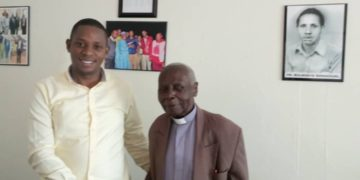 Rogers Bulegeya with Canon Njoji at his office located in Masaka Town.