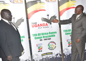 Former Sports Minister Charles Bakabulindi with NCS boss John Bosco Onyit