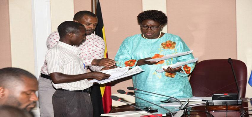 Speaker Kadaga (R) receives the petition