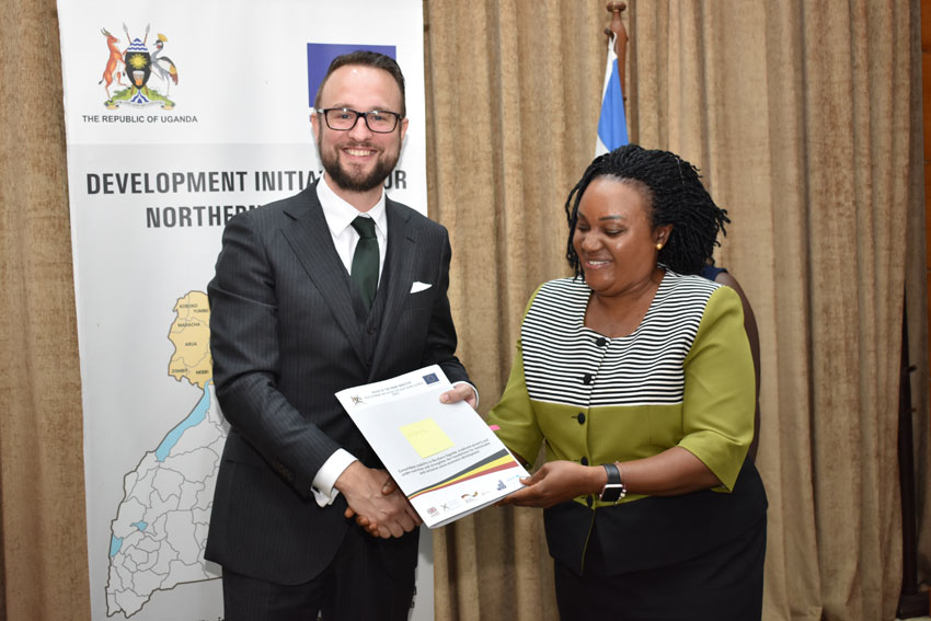 Ms Christine Guwatudde Kintu (Right), the Permanent Secretary at the Office of the Prime Minister (OPM), congratulates Mr Mathias Kamp, the country director of Konrad-Adenauer-Stiftung, one of the grantees shortly after signing the DINU grants contract at the OPM in Kampala on January 14, 2020.