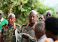 President Museveni talks to locals during a break