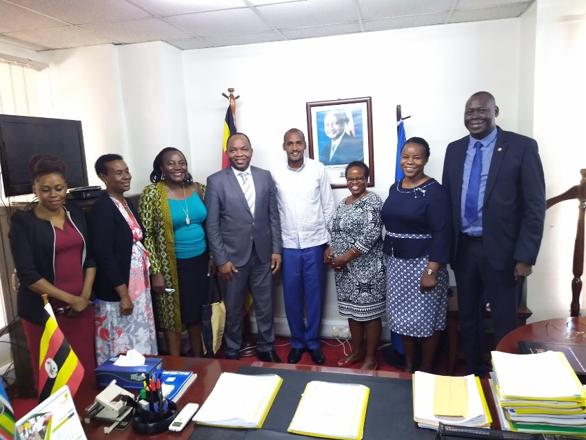 UN Women Country Representative, Dr. Maxime Houinato and Minister for Gender, Labour and Social Development Frank Tumwebaze after the meeting at the Ministry headquarters on Wednesday
