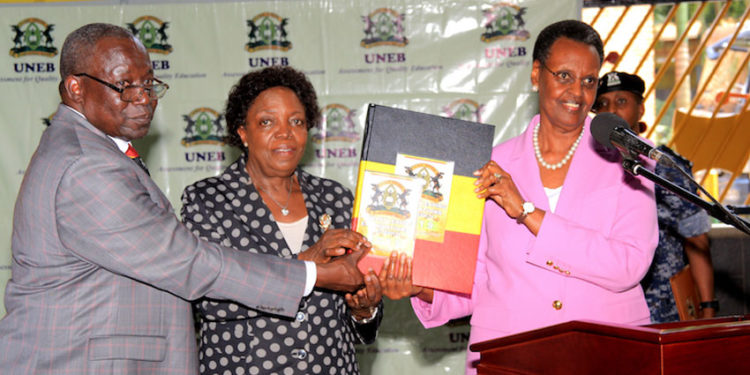 L-R: UNEB Executive Secretary Dan Odongo, UNEB Chairperson Prof Mary Okwakol and Education Minister Janet Museveni releasing the 2019 PLE results