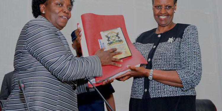 Education minister Janet Museveni (right) receives previous results from UNEB chairperson Mary Okwakol