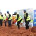 Richard Byarugaba, the NSSF MD (Centre) during the ground breaking of the Lubowa housing project