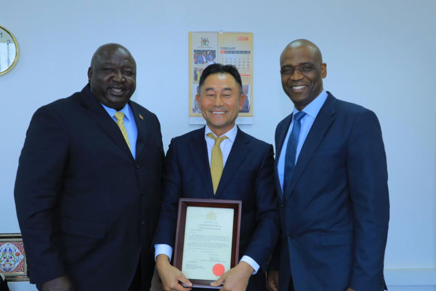 Minister of state in charge of International Affairs Mr Henry Okello Oryem with Mr Lee Sung [middle]