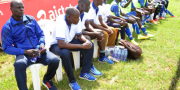 Steven Bogere and the late Jimmy Kisekka (Second-left) at Buddu technical bench recently. PHOTO BY BRIAN MUGENYI.