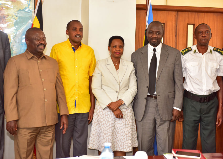 Minister Tumwebaze (middle) with Lt Col Edith Nakalema, the head of State House Anti Corruption Unit