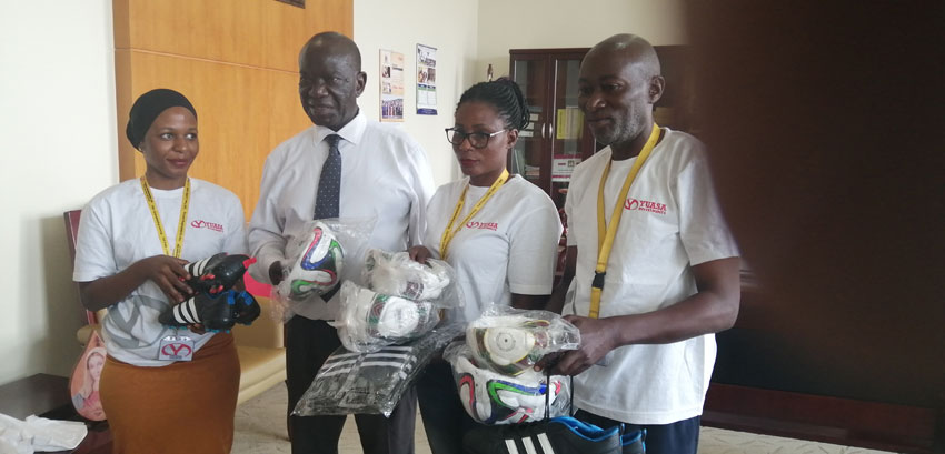 Yuasa officials handing over sports equipment to the Vice President