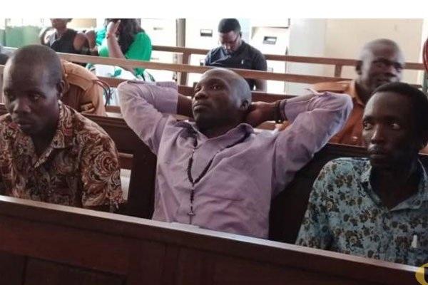 Brian Bagyenda (R) in Court