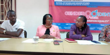 Associate Professor Consolata Kabonesa, the principal investigator of the Gender Mainstreaming project [m] and Associate Professor Sarah Ssali, the Dean School of Women and Gender [r] addressing the media on Saturday