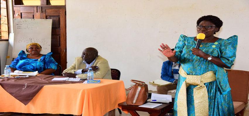 Speaker Kadaga (R) addressing the leadership of Kamuli district