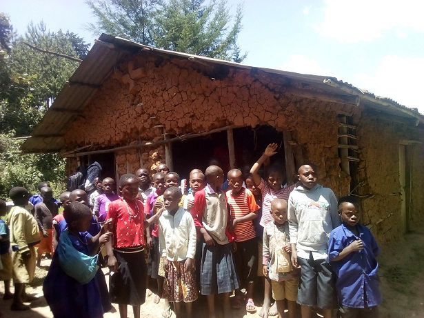 Some of the pupils infront of one of the ramshackle structures at Murungu Primary School