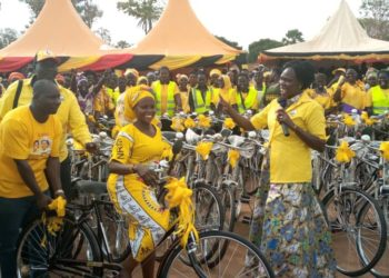 Minister Anite handing over bicycles to Women Council leaders