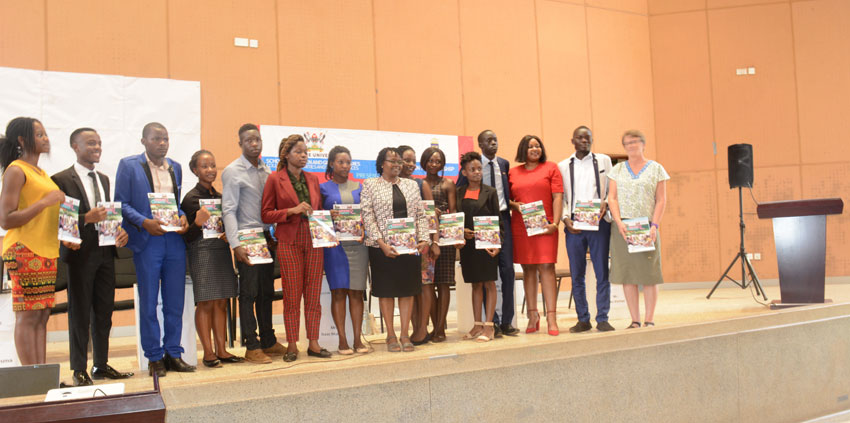 Students from various universities in Uganda with Associate Professor Consolata Kabonesa, the Principal Investigator Gender mainstreaming project at Makerere University on Thursday