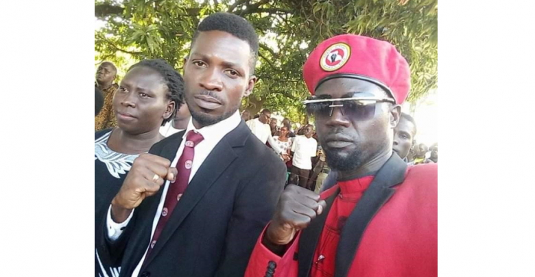 Bosmic Otim and Bobi Wine in happier times