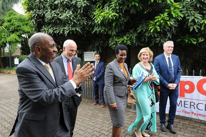 Prime Minister Rugunda arrives for the Uganda-Europe Business Forum on Monday. He was welcomed by by H.E. Attilio Pacifici, the Ambassador of the EU to Uganda (2L) and Trade minister Amelia Kyambadde