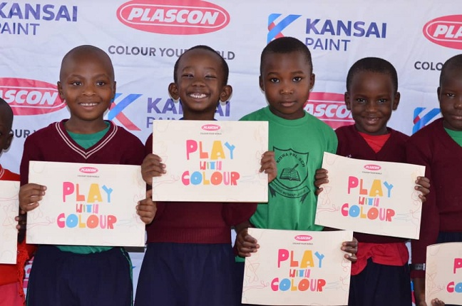 Pupils at Kiswa Primary School display the newly launched colour books