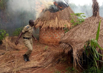 A police officer at the shrine of a traditional healer