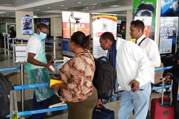Travellers undergo health checks at the Entebbe International Airport on February 6, 2020