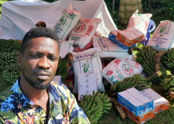 Bobi Wine with his rejected food relief