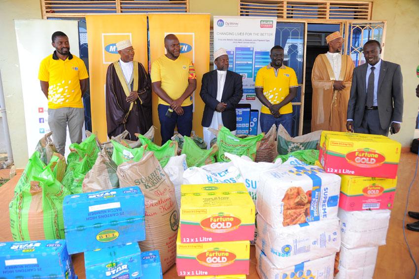 MTN staff hand over food items to the Supreme Mufti Kasule Ndirangwa at Kibuli Mosque