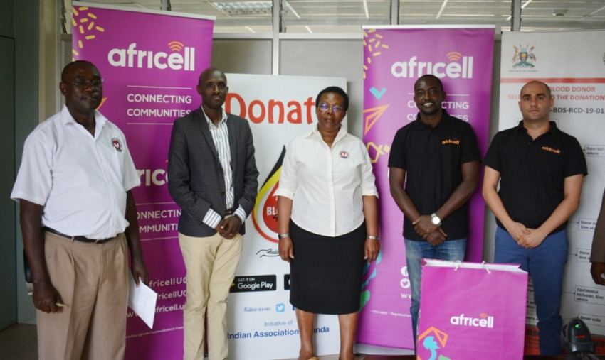 Uganda Blood Transfusion Services (UBTS) Public relations officer Mr Michael Mukundane (left), and UBTS executive director Dr Dorothy Nakyeyune (centre), pose for the photo with the Africell IT manager Mr Innocent Mbiro (2nd left), Public relations officer Edgar Karamagi (2rd right) and marketing manager Marc Aad (extreme right).