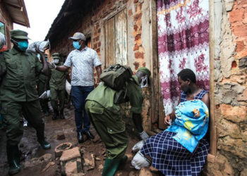 A woman receiving food relief a few days ago