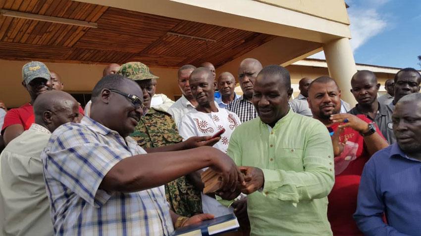 MP Asuman Basalirwa handing over the Shs20m covid19 cash to Bugiri District taskforce
