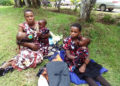 Niwandinda with her triplets at Kabale district headquarters