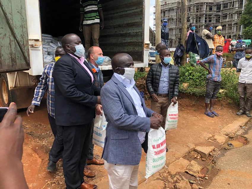COVID-19: Single mothers, widows affected by lockdown benefit from East African Partners' relief food