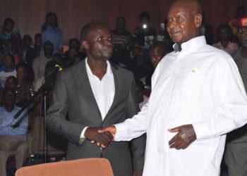 Ronald Mayinja with President Yoweri Museveni in 2019