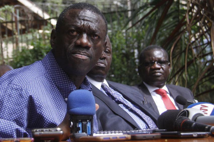 Dr Kizza Besigye and  Patrick Oboi Amuriat (extreme right)