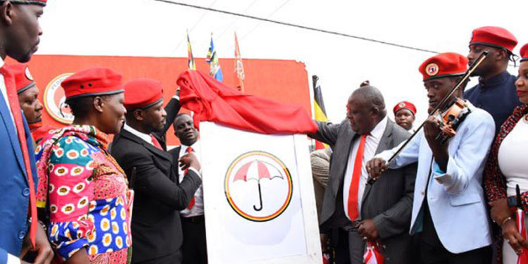 Bobi Wine and Moses Kibalama during the launch of NUP party last year