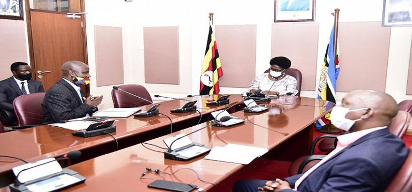 Speaker Kadaga(C) meets representatives of the rural broadcasters