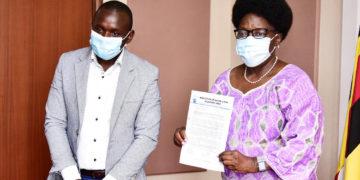 Speaker Kadaga receiving the petition from Abdu Karim Mucunguzi, the association's chairperson.
