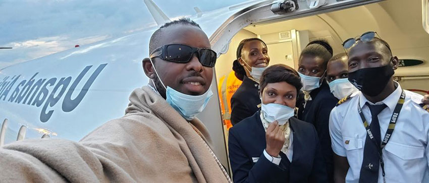 Eddy Kenzo with Uganda Airlines cabin crew on Friday