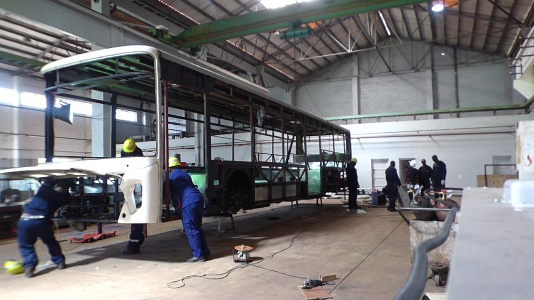 Kiira Motors engineers working on the Kayoola EVS Bus at Luweero Industries in Nakasongola Baracks