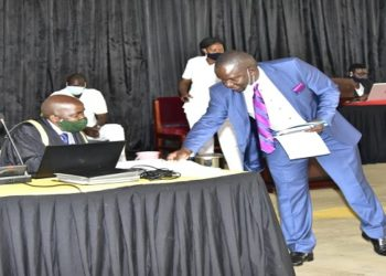 Mwiru(R) lays the bill on table after it's First Reading