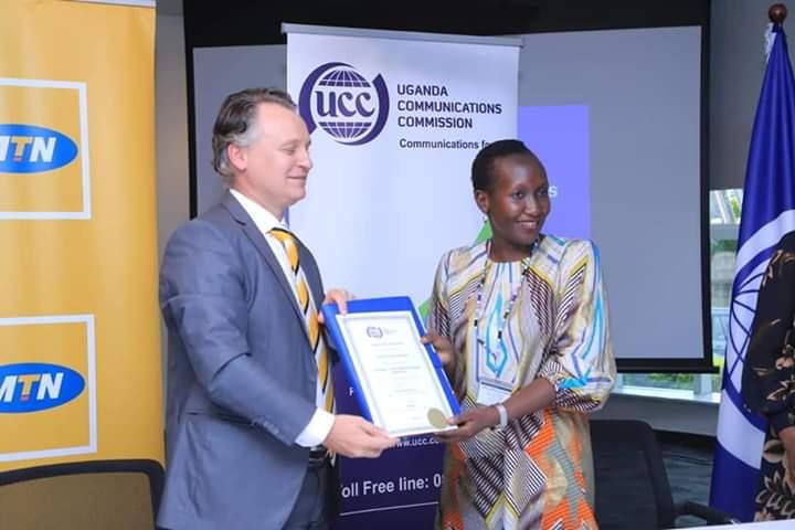 MTN CEO Wim Vanhellpute and UCC Executive Director Irene Kaggwa Sewankambo