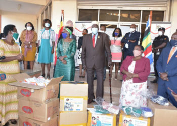 Moses Ali, the First Deputy Prime Minister(C) flags off a consignment of face masks that were to be distributed in some parts of the country on June 11