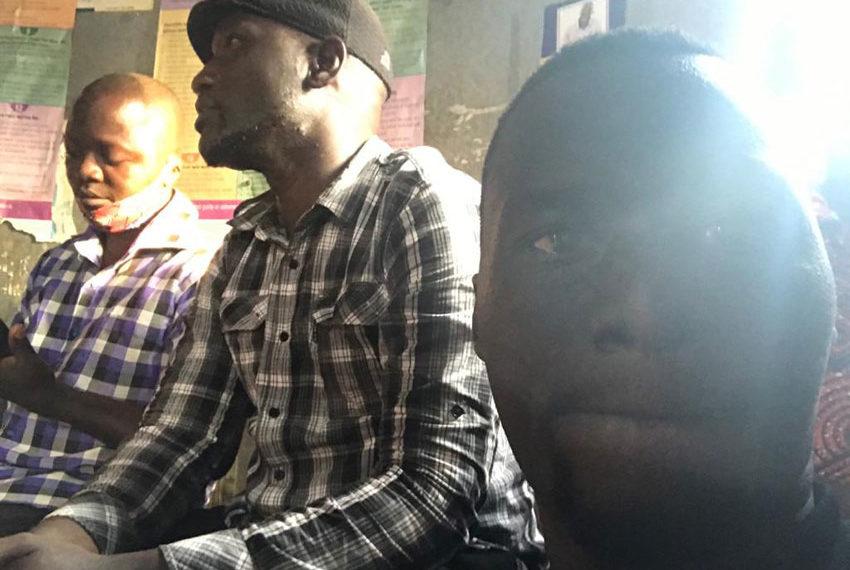 Eddy Yawe and colleagues at Kirinya Police Station