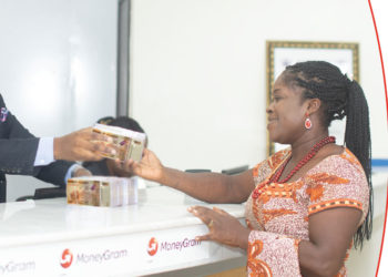 A lady using Money Gram services