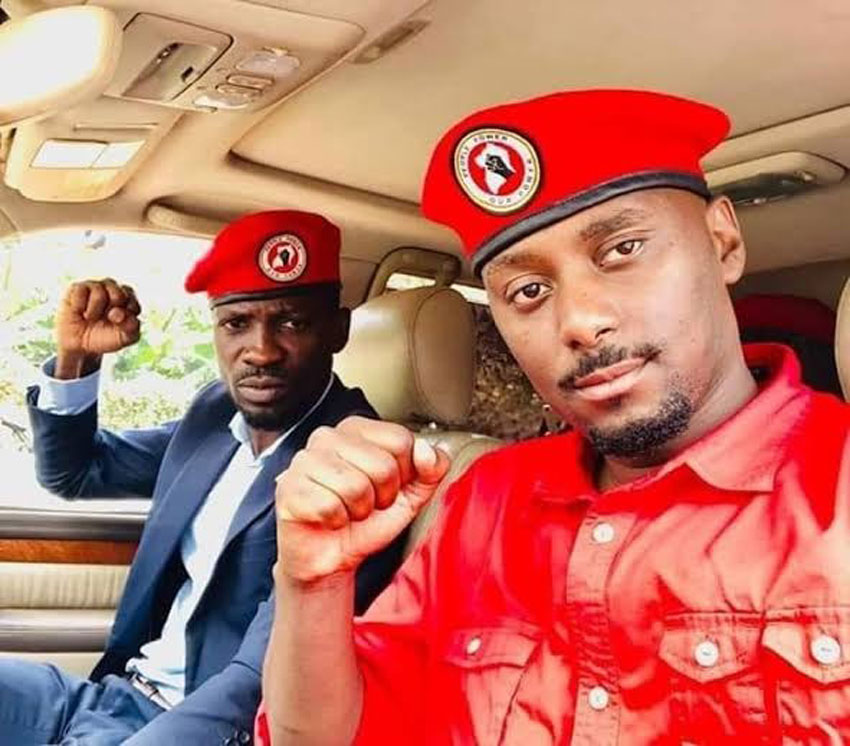 Bobi Wine with People Power Executive Secretary, David Lewis Rubongoya