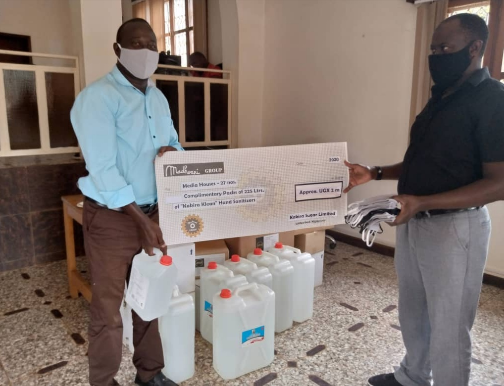 Mike Ssegawa receives masks and sanitizers on behalf of Watcdog News from Mr Ismail Sentamu, Program Officer, Learning and Strategy atbTwaweza East Africa as part of a donation from Twaweza and Madhvani Group to the media fraternity.