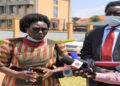 MPs Cecilia Ogwal (L) and Charles Angiro Abacacon addressing journalists after attending Police Disciplinary Court in Naguru, Kampala