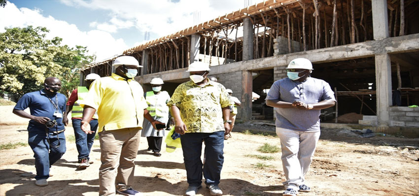 Oulanya(C) after touring construction works at the Arua stadium